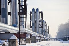 Overground heat pipes. Pipeline above ground, conducting heat for heating the city. Winter. Snow. Overground heat pipes. Pipeline above ground, conducting heat Stock Photos