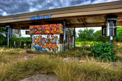 Overgrown Abandoned Gas Station Covered with Graffiti Royalty Free Stock Images