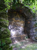 Overgrown alcove in rock. Italy Stock Photography