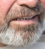 Overgrown beard man. Photos in the studio Royalty Free Stock Image