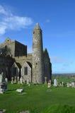 Overgrown Cross Ruins. Grass over growing a fallen cemetery cross in Ireland Royalty Free Stock Photo