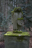 Overgrown grave stones. At a cemetery stock image