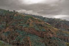 Overgrown mountains and dark storm clouds. Portuguese island of Madeira royalty free stock photos