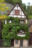 Overgrown old half-timbered house Stock Photos