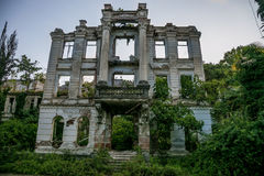 Overgrown ruins of abandoned palace, Abkhazia. Green post-apocalyptic concept. Overgrown ruins of beautifull abandoned palace, Abkhazia. Green post-apocalyptic royalty free stock photo