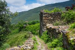 A hiking trail through overgrown ruins and lush landscape in the Portuguese countryside royalty free stock photos
