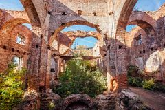 Free Overgrown Ruins Of Red Brick Church Royalty Free Stock Images - 133634879
