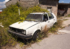 Overgrown scrapped car Royalty Free Stock Photos