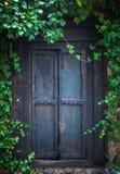 Overgrown Secret Garden Door. Ivy Surrounding An Old Wooden Door To A Secret Garden At An Old Mansion House royalty free stock image