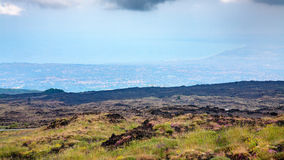 Overgrown slope of Mount Etna and Ionian Sea coast Royalty Free Stock Images