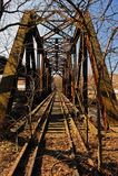 Overgrown Train Tracks and rusty bridge. Stock Image