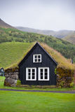 Overgrown Typical Rural Icelandic house at overcast day Stock Photography