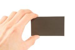 Overhandig holding leeg adreskaartje stock foto