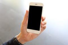 Overhandig holdingssmartphone Royalty-vrije Stock Foto
