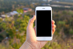 Overhandig holdingssmartphone Stock Foto's