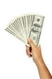 Overhandigen de Mensen holding honderd dollarsrekening op witte achtergrond Stock Foto's