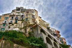 Overhanging houses overlooing at the seafront in Tropea, Calabr royalty free stock image