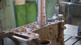 Overhaul of a car engine. Boring the cylinder block of an internal combustion engine stock video