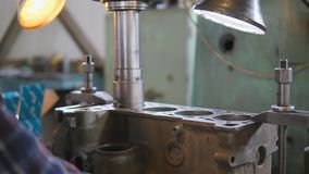 Overhaul of a car engine. Boring the cylinder block of an internal combustion engine stock footage