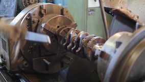 Overhaul of a car engine. Installing the crankshaft of an internal combustion engine in a cam chuck of a metal processing machine stock video footage