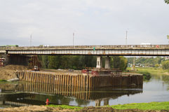 Overhaul of the road bridge over the river Royalty Free Stock Images