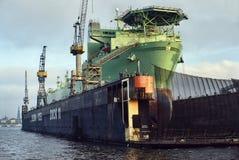 Overhauling an Off-shore vessel. Norwegian Prospector Vessel Berge Hugin in the Floating Dock at Blohm + Voss Shipyard in Hamburg, Germany royalty free stock images