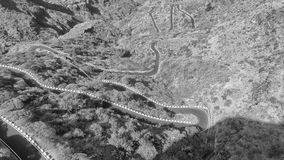 Overhead aeria view of beautiful road through the mountains.  royalty free stock images