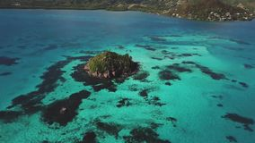 Overhead aerial drone view of a Caribbean cay. Surrounded by clear blue waters stock video