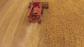Overhead Aerial footage harvester at work stock video