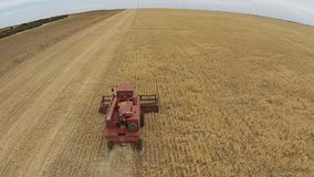Overhead Aerial footage harvester at work stock footage