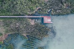 Overhead aerial shot of a small fishing spot near a lake royalty free stock images