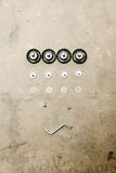 Overhead of allen key and screws for furniture assembly Stock Image