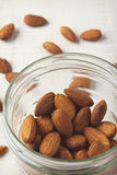 Overhead of almonds in mason jar with white rustic background Royalty Free Stock Image