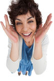 Overhead of amazed woman with hands wide opened Royalty Free Stock Photography