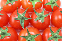 Overhead of baby tomatoes. Overhead of a group of baby tomatoes stock photo