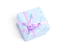 Overhead of blue gift box with purple ribbon Stock Image