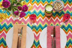 Overhead Bright colorful table setting with chevron tablecoth Stock Images