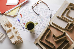 Overhead of building model and drafting tools on a construction plan. Objects by architectural project Stock Photos