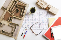 Overhead of building model and drafting tools on a construction plan. Stock Images