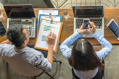 Overhead business angle of Asian employees working royalty free stock image