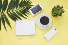 Overhead business frame with  a solar battery, phone and cup of coffee. Top view. Overhead business frame with  a solar battery, phone and cup of coffee Royalty Free Stock Image