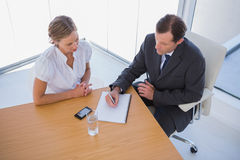 Overhead of business people taking notes Stock Images