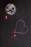 Overhead of chalkboard, chalk and heart shape drawing Stock Photography