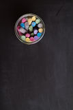 Overhead of chalkboard and jar of colored chalk Royalty Free Stock Photos