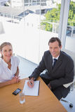 Overhead of cheerful business people taking notes Stock Image