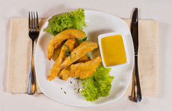 Overhead of Chicken Fingers with Honey Mustard Royalty Free Stock Photo