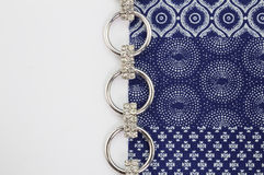 Overhead close up of indigo printed cloth whith chain silver and Stock Photos