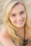 Overhead Close up portrait of smiling blond at beach Royalty Free Stock Photos