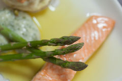 Overhead close up of salmon dish with asparagus Royalty Free Stock Photography