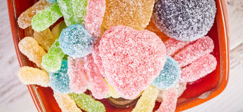 Overhead close up view of gum drops and gummy worm Royalty Free Stock Photo